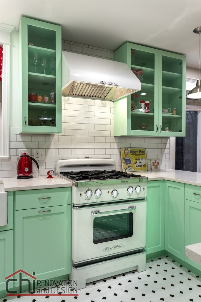 A-bold-mint-green-kitchen-in-combination-with-a-retro-stove.jpeg