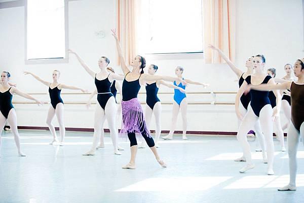Ballet teacher teaching combination
