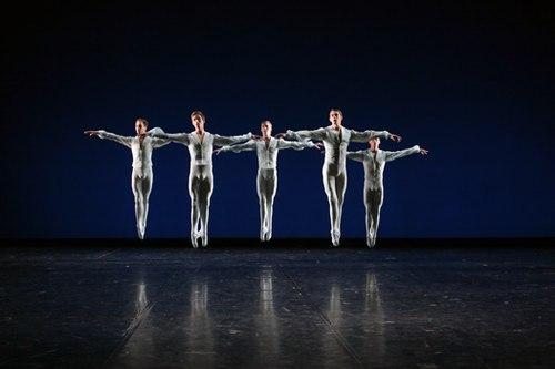 5 men jump in air