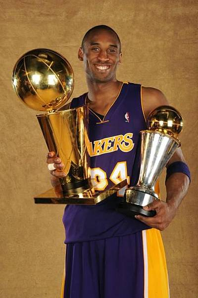 Kobe Bryant poses with both Larry O_Brien trophy and his 2009 NBA Finals MVP trophy