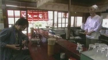 不回北海道 拿錢給店長.JPG