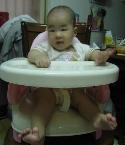 Baby Summer is sitting on Summer Infant!!!.jpg