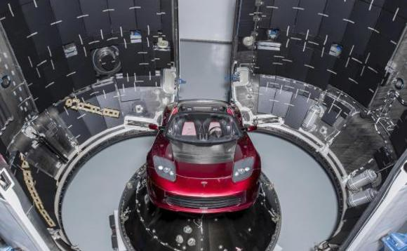 red Tesla Roadster into orbit on SpaceX's Falcon Heavy rocke.jpg