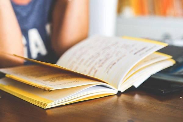 girl-reading-a-notebook.jpg