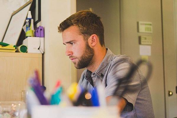 young-man-sitting-and-working-at-desk.jpg