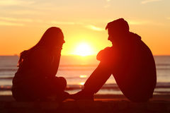 friends-couple-teens-facing-sunset-side-view-full-body-two-silhouette-beach-sun-middle-76485092.jpg