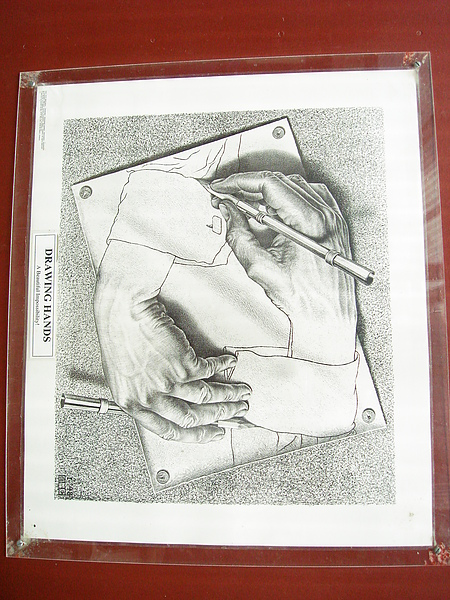 A hand drawing a hand