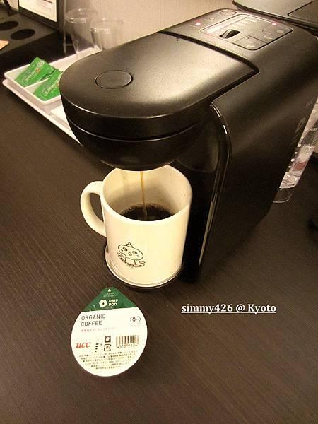 膠囊咖啡機使用中.jpg