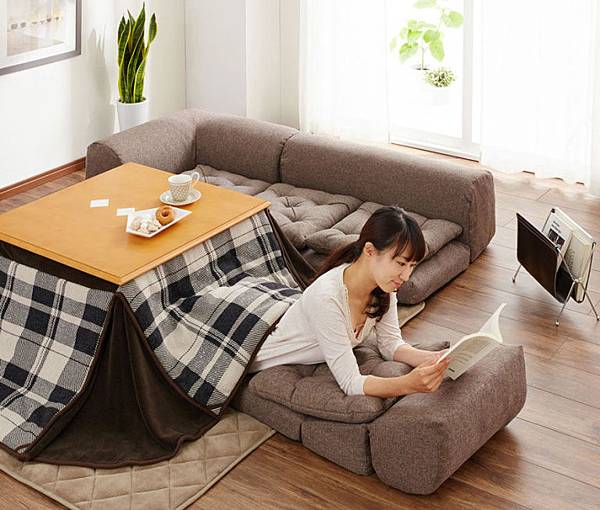 gallery-1446133965-kotatsu-japanese-heating-bed-reading.jpg