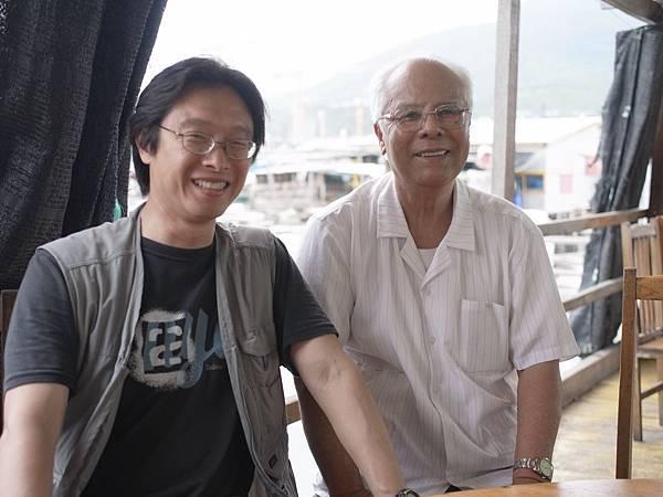 014譚端與老兵黃廣海在海南島尋找60多年前撤退的港口.jpg
