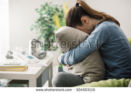 stock-photo-unhappy-lonely-depressed-woman-at-home-she-is-sitting-on-the-couch-and-hiding-her-face-on-a-pillow-504503110.jpg