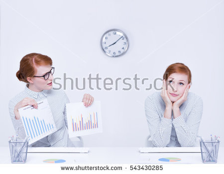 stock-photo-conscientious-and-distracted-office-worker-sitting-at-desk-543430285.jpg
