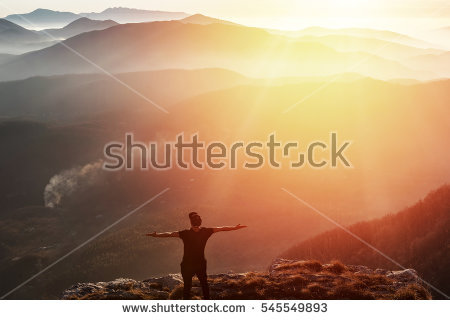 stock-photo-man-on-top-of-mountain-celebrating-succes-trip-concept-545549893.jpg