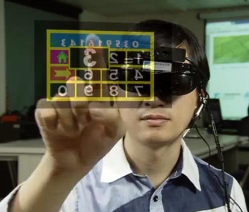 i-Air Touch頭戴式顯示器讓用戶可觸控啟動懸浮於半空中的虛擬螢幕