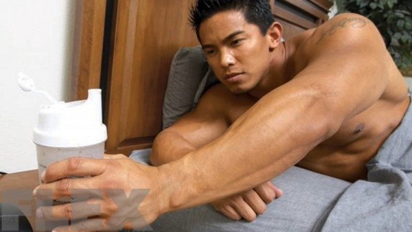 reaching-for-protein-shake-in-bed_0