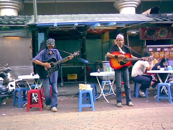 街头艺人 in Petaling Steet