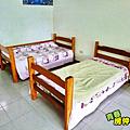頂樓臥房裡的床鋪.PNG
