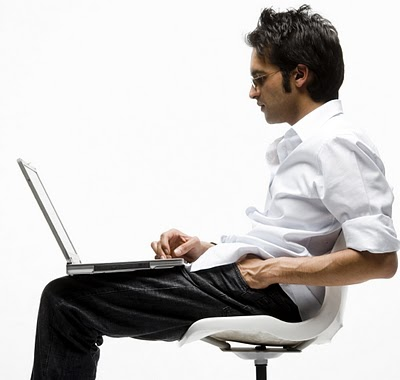 Man reading laptop screen smaller