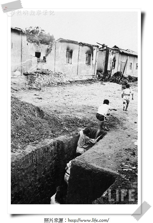 Children in Kwang Li village, play follow the leader in real trenches.jpg