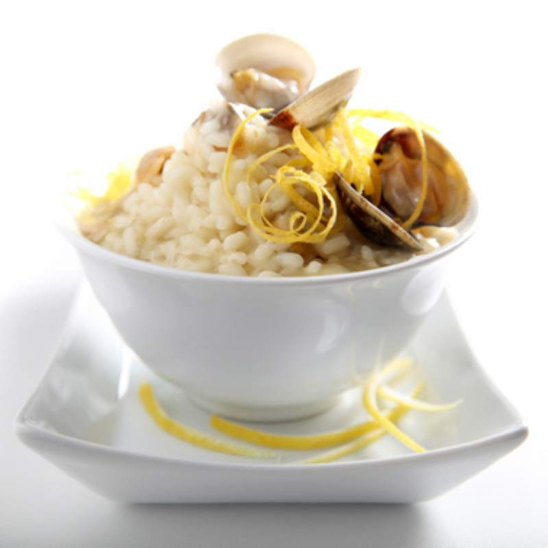 Acquerello rice mixed with Adriatic clams and Sorrento citron zest flavoured with Olitalia - Colline di Romagna (P.D.O.) extra virgin olive oil