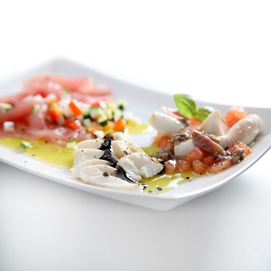 Carpaccio of red tuna with vegetable and oil pesto and Olitalia - 100% Italian Oro extra virgin olive oil, scallop muscles and steamed squid with a tomato and salted-anchovy tartare