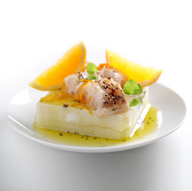 Escallop of amberjack caramelised in citrus fruits on cervia sweet sea-salt block and Olitalia - Colline di Romagna (P.D.O.) extra virgin olive oil