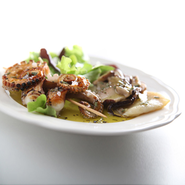 Pan-fried fillet of turbot with porcini mushrooms from the Alto Savio valley flavoured with Olitalia - Terra di Bari (P.D.O.) extra virgin olive oil and Roasted octopus kebabs in rosemary and coarse sea-salt from Cervia