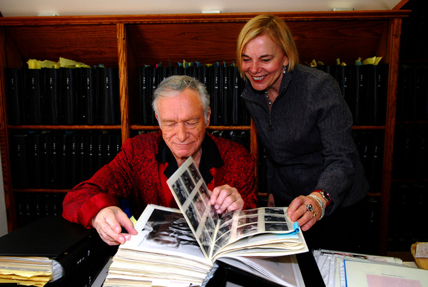 Hugh Hefner and Director Brigitte Berman in the scrapbook office at the Los Angeles Playboy Mansion by Elayne Lodge.JPG