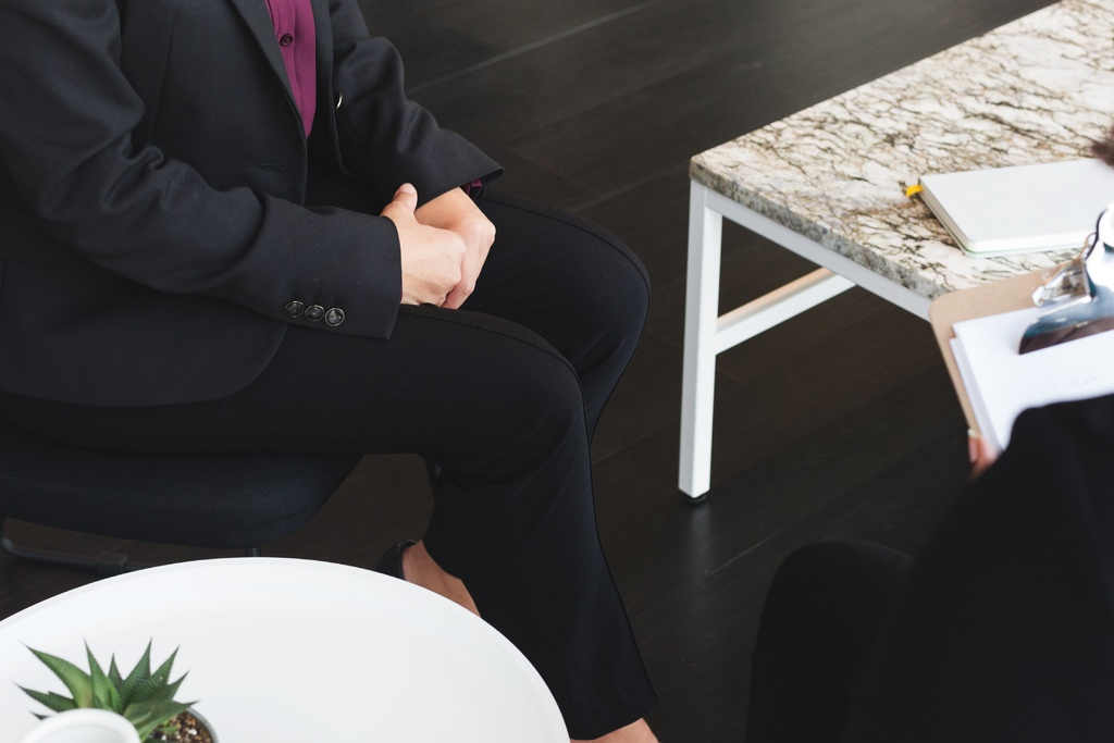 business-woman-sits-for-job-interview.jpg
