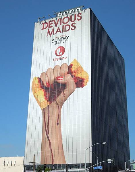 giant Devious Maids billboard