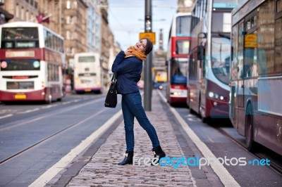 pretty-girl-walking-on-the-road-100245783