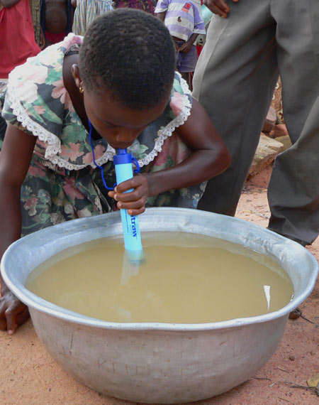 child-drinking-LifeStraw-with-metal-bowl.jpg