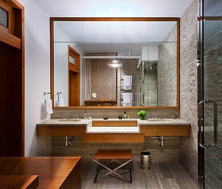 Brick-Wall-Studio-Apartment-by-Stephan-JAKLITSCH-GARDNER-elemental-wooden-framed-bathroom-with-stone-feature-wall.jpeg