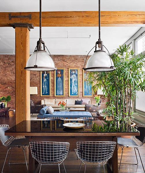 Brick-Wall-Studio-Apartment-by-Stephan-JAKLITSCH-GARDNER-exposed-beam-dining-lit-by-industrial-pendant-lights-with-wire-chairs.jpeg