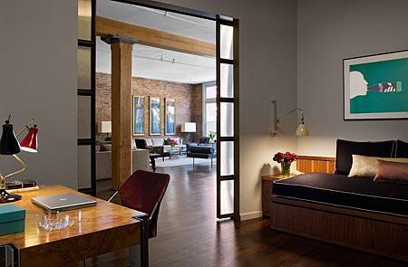Brick-Wall-Studio-Apartment-by-Stephan-JAKLITSCH-GARDNER-hardwood-floor-bedroom-with-walnut-desk-and-japanese-style-double-doors.jpeg