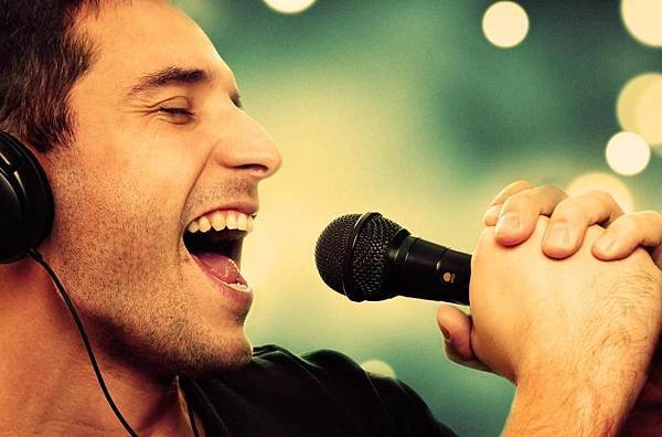 singer-holds-microphone