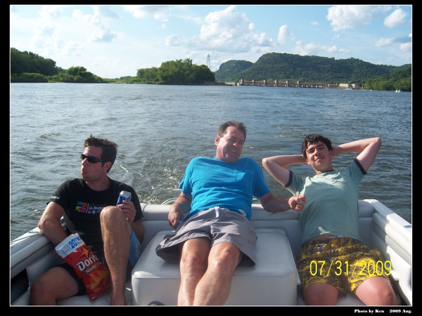 Ken and Ellis in back of boat for ride with friend Dan from Germany