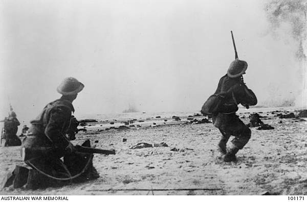 A British soldier on Dunkirk%5Cs beaches fires at strafing German aircraft.JPG
