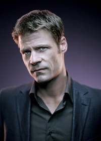 Joel Gretsch as Tom Baldwin.jpg