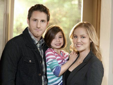 Sam Jaeger as Joel Graham, Savannah Rae as Sydney Graham, and Erika Christensen as Julia Braverman-Graham.jpg