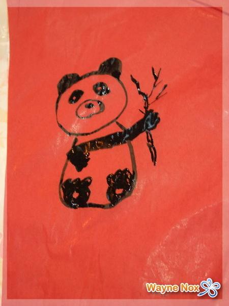 啃爺爺的貓熊.jpg