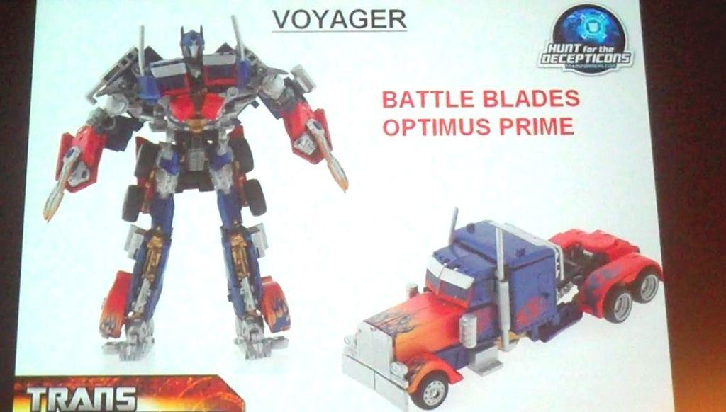 .............Battle-Blades-Optimus_1266180962(  新的擎天柱玩具,胸前可以收纳领导模块!配备枪与斧头等武器)