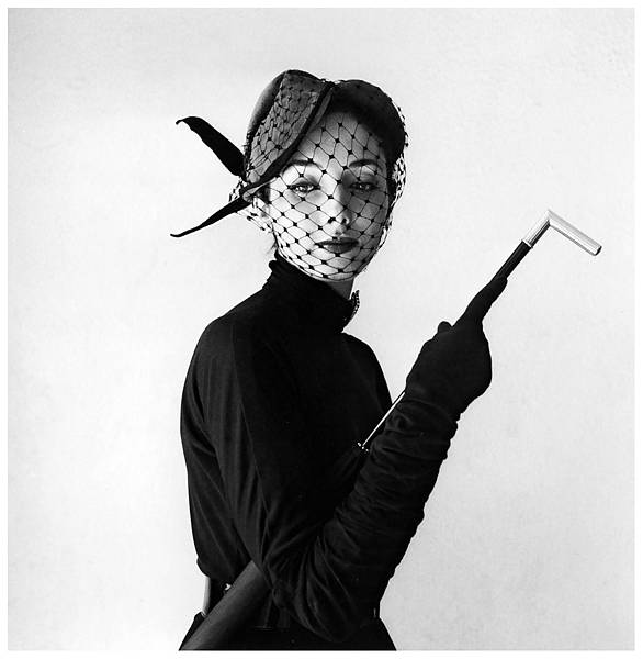 model-is-wearing-a-charming-afternoon-hat-with-veil-by-jacques-fath-photo-by-willy-maywald-1951.jpg