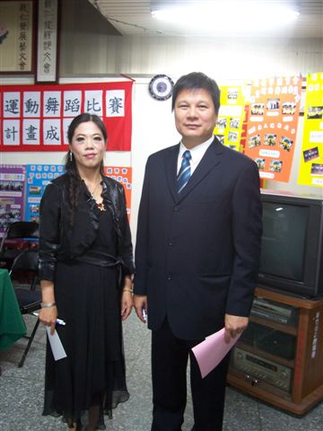 總幹事洪錦華與張謙裕老師合影