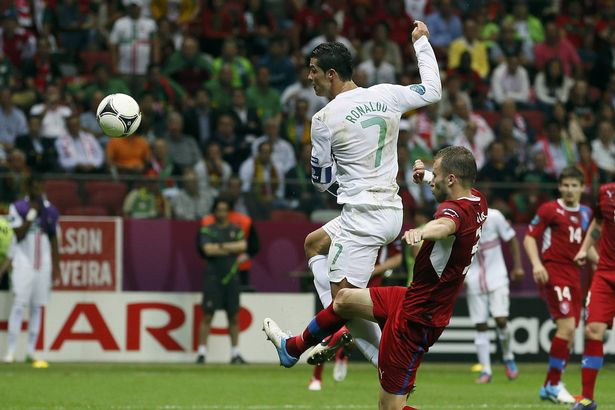 Cristiano+Ronaldo+heads+the+ball+to+score+