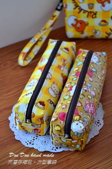 夾層存褶包。方型筆袋(1)
