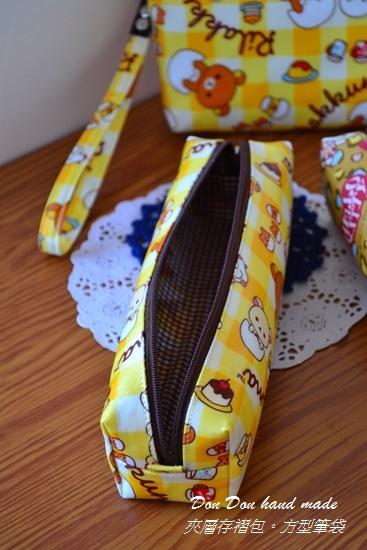 夾層存褶包。方型筆袋(2)