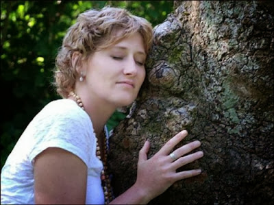 Kiesha-hugging-tree-550x411