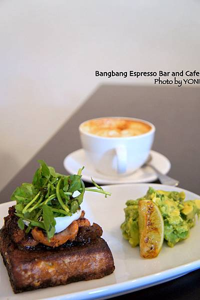 French toasted brioche topped with spicy onion jam, grilled chorizo, poached egg, watercress and a side of avocado & coriander crush (AUD 16.50)