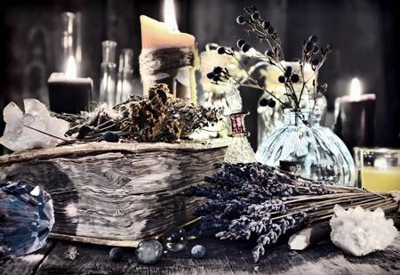 95807579-antique-witch-book-with-lavender-flowers-magic-ritual-objects-healing-herbs-crystal-and-black-candle.jpg